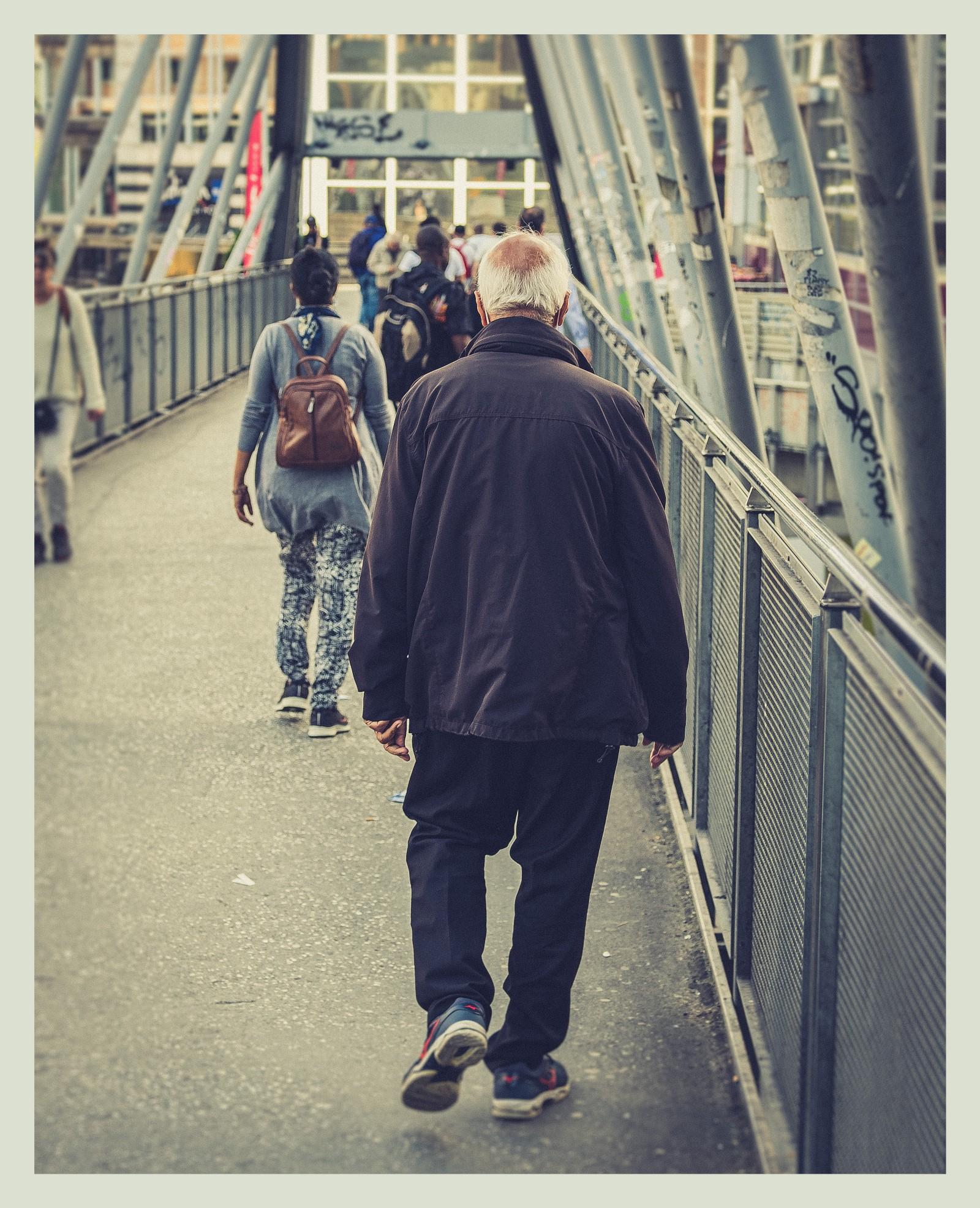 People walking over bridge